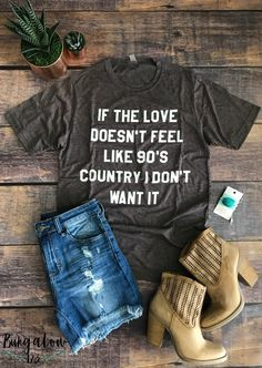 """If the Love Doesn't Feel Like 90's Country I Don't Want It""! This tee is going to feel like your favorite vintage shirt from the 90's! This Poly/Cotton shirt is printed using water-based print, making it super-soft with a lived-in feel. Laundered for reduced shrinkage, with crew neck styling. Sizes are Unisex, shirt shown is a size small."