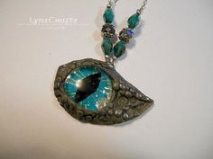 Rock Dragon's Eye gunmetal & teal polymer clay jewelry pendant necklace charm handmade one of a kind by LynzCraftz on Etsy