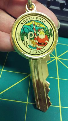 North Pole Alaska Key shaped Key Chain - North Pole Alaska City seal with Santa. Clicking on the View Page button will take to you to our eBay store listing for this keychain.  When you click the following link, it will take you to our Way Up In Alaska Keychain page :    http://www.wayupinalaska.com/Key-Chains.html