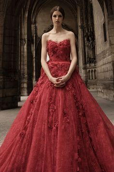 This red wedding dress is so eclectic. Hian Tjen Couture Wedding Gown Collection |  via @WedLuxe