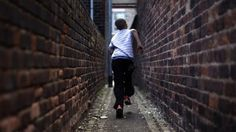 "Student running down an alley. UK teachers warn of 'Victorian' poverty among pupils. Teachers say they are seeing ""Victorian conditions"" with pupils arriving at school hungry and not wearing the right clothes needed for the weather. The NASUWT teachers' union says schools and teachers are increasingly having to deal with the consequences of poor housing and poverty. Teachers reported bringing in their own food to school to give to children. #poverty #students #teachers #UK #Britain…"