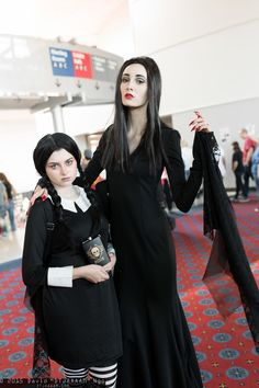 Wednesday and Morticia Addams