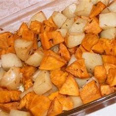 Russet, red and sweet potatoes are roasted with olive oil, garlic and balsamic vinegar in this tasty low-fat side dish.