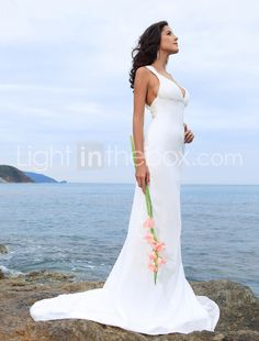 Beautiful simple gown. Sleek cut, no distinct waistline, lots of boobie.