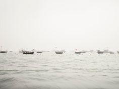 PATIENCE - Color Photographs by Josef Hoflehner & Jakob Hoflehner Boats in Fog (Vietnam, 2012)