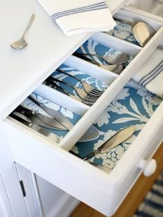 Leftover wallpaper can be used to spruce up the insides of your drawers or cabinets...