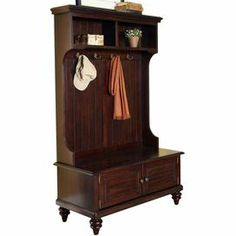 """Hall tree in espresso with two shutter doors and antiqued brass hardware. Product: Hall treeConstruction Material: Rubber wood and veneersColor: EspressoFeatures: Two shutter doors and four double hooksDimensions: 64.5"""" H x 40"""" W x 18.5"""" D"""