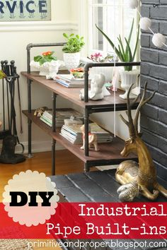 awesome diy pipe built in shelves for next to a fireplace!  great inexpensive way to have built ins!