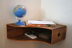 This wooden magazine holder from ikea turned out to be the perfect catch all shelf for little items like keys, accessories and bills. All you had to do was put a coat of stain on it, turn it on its side and mount it in the corner of our entryway. http://hative.com/diy-ideas-with-magazine-storage-box/