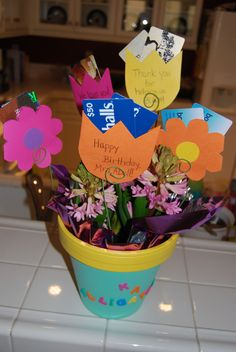 Giving Tree - great for a class teacher's gift!  Make flower gift card holders and stick them into a potted plant. Favorite candy in bottom to hold in flowers