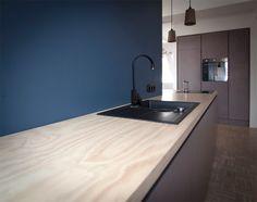 Grey MDF fronts with dull matt oil/wax finish. Radiata pine worktop, Farrow and Ball Stiffkey blue backwall.