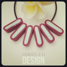 Plain and Simple - hand crafted resin neck wares. No two pieces will ever be exactly the same in colour or finish. Uneek 2 U, made personal by me