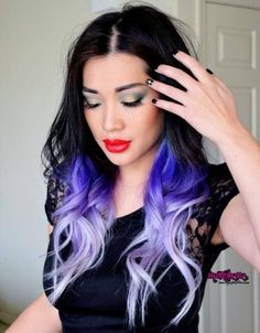 This Dye-Dip goes from a midnight black to a gorgeous blue fading into a subtle light purple almost white looks amazing and is a great way to express yourself through hair coloring.