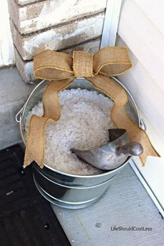 Ice-Melt Storage Solution For The Front Porch. Keep it right where you need it (out of the elements) but pretty it up a bit. See post for tips. {lifeshouldcostless.com}