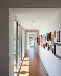 Re-Thinking the Gallery Wall: Make a long, narrow row of art down a long hallway, pulling people through a space.