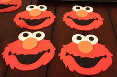 Cut Elmo out of red, black, orange & white foam, print party info on cardstock and glue on back with magnet.  Cute invitation!