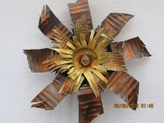 Upcycled tin can flower by MommaGrammyCrafts on Etsy