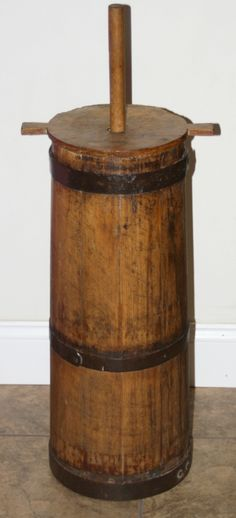There's the butter churns I like :) 19th Century Staved Wooden Butter Churn