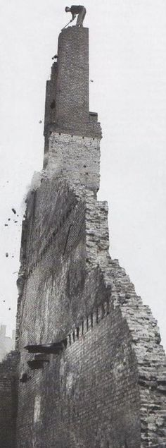 This photo might trigger vertigo in most people!A workman perched atop this shaky chimney, all that is left of the building, is chipping away with a hammer. London during the Blitz, The question is: how did he climb up there? Old Pictures, Old Photos, Vintage Photos, London History, British History, The Blitz, Old London, Blitz London, World War Two