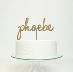 Add a personalised and delicate name topper to the top of your cake.The colours available are black, white, navy, royal blue, turquoise, lilac, baby pink, fuchsia, red, gold glitter, holographic glitter, black/silver glitter. The photo shows gold glitter. The topper can be personalised with any name or word.This cake topper would be perfect for any celebration, such as a birthday, new baby or Christening. You can choose any name or word. It would be perfect to decorate any cake, dessert…