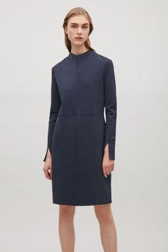 COS image 2 of Dress with twisted sleeve seams in Navy