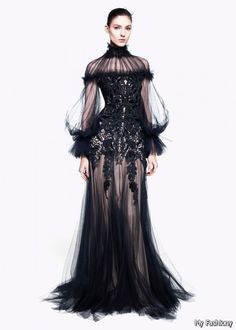 mcqueen 2016 black floor dress's inspiration were come from 1850 to 1860. the Corset is very tight and can show the women body line very well. however the dress doesn't has crinoline, seems come from 1892 Asethetic style line.