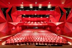 Intense red in the the amphitheater of the Agora Theatre (Lelystad, NL) where drama and performance are not restricted to the stage, but extend to the whole urban experience. (UN Architects).  Iwan Baan, photographer.