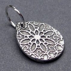 This pendant was created using fine silver which has been carefully textured, fired, oxidized to add contrast and then hand polished in my studio.