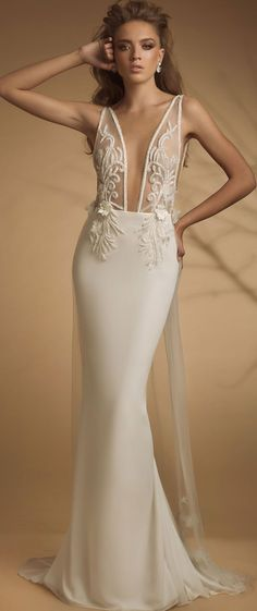 Sleeveless deep v plunging neckline heavy embellishment fit and flare wedding dress sweep train #wedding #weddingdress #weddinggown