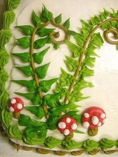 Buttercream ferns and mushrooms