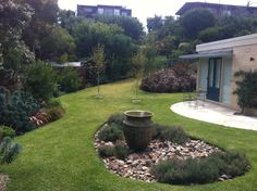 blairgowrie back yard where we created a water feature to hide the septic treatment plant pool deckslandscaping ideasgarden