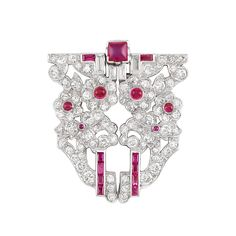 Platinum, Diamond and Ruby Clip/Brooch 86 round & 4 baguette diamonds ap. 1.75 cts., one sugarloaf cabochon ruby, 5 round cabochon rubies, rectangular-cut rubies, c. 1930, ap. 9.8 dwts.