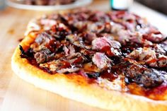 Steakhouse Pizza--skirt steak, red onions, balsamic vinegar, w. sauce, red sauce, mozzarella, parmesan cheese, and steak sauce...hmm...?