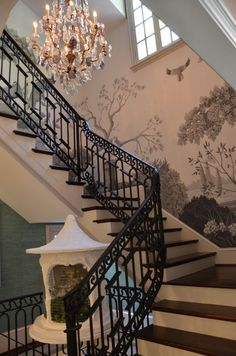 """""""Family"""" Stairwell by The Mercantile - 2013 Atlanta Symphony Show House and Gardens. Baccarat chandelier with amethyst crystals, original wallpaper by Bethany Travis; Residential design by William T. Baker."""