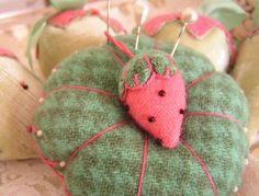 Green plaid pin cushion with sweet little strawberry