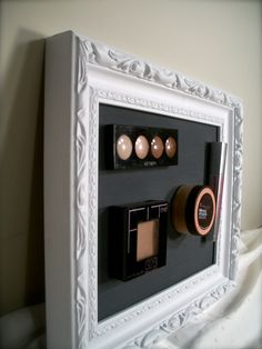 Magnetic make-up frame...I made mine with a frame from dollar tree and used homemade mod podge to adhere the fabric....love my frame!