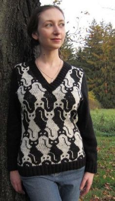 Wool v-neck with a cat tessellation motif, worked in fair isle knit with fitted side shaping. Solid sleeves are worked in stockinette with ribbed turn-down cuffs. Knitted Cape Pattern, Cat Pattern, Neck Pattern, Cool Patterns, Knitting Patterns, Cat Sweaters, Fair Isle Pattern, Fair Isle Knitting, Knitting Charts