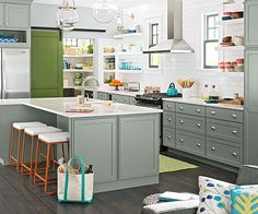 3 Tips for Pairing Cabinetry + Countertops. Love the neutral cabinetry with the pops of green, persimmon & turquoise.