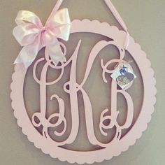 3 letter wooden scalloped circle monogram door hanger with bow 24x24 on Etsy, $115.00