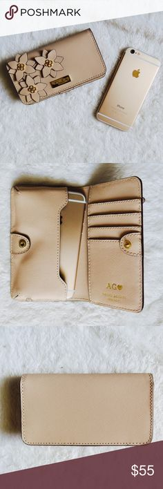 """Henri Bendel West 57th Smartphone Clutch Case +Brand: Henri Bendel  +Listed Size: Fits iPhone 6 and smaller.  +Color: tan color and gold.  +5.75"""" x 3.25"""" x 1"""" +Features: slot for iPhone, holes for charger and earphones so you can use while phone Is inside. 4 credit card slots and a larger slot.   -Flaws: none. AG(heart) is monogrammed inside.  * I do NOT trade.  * Please make offer using the """"OFFER"""" button * Bundle for additional savings! henri bendel Accessories Phone Cases"""
