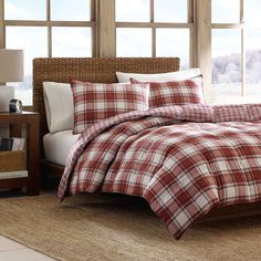 A red and white plaid pattern adds traditional charm to the Edgewood down alternative comforter set, reversing to a handsome mini-plaid pattern. Machine washable and comfortable, this soft brushed microsuede comforter set is designed by Eddie Bauer.