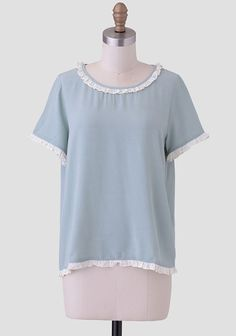 Charming and chic, this dusty mint-colored top is accented with ruffles at the hems adorned with a sweet polka dot print. Style this lovely top with your favorite skinny jeans and T-strap heels ...