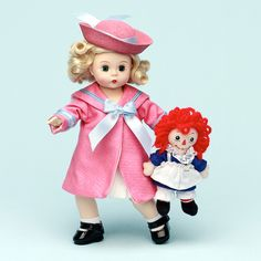 Madame Alexander Doll: Marcella Loves Raggedy Ann - Certainly looks like a nautical gal in her pink & blue with her Hannah doll!