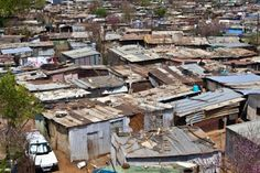 These are townships: the poor shantytowns that black South Africans used to live when the South African apartheid system was in effect. Some black South Africans still live in them today. Geography, South Africa, Street View, Camping, Tours, Change, City, Places, Today History