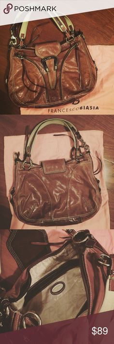 "Francesco Biasia Leather Purse Pre-Owned; in good condition. Beautiful brown leather purse by Francesco Biasia. Magnetic snap closure and full zip shut. One interior zipper and two open pockets. Exterior has two front zipper pockets. Length: approx 16"". Height: approx 10"". Width: approx 2.5"". Strap drop: approx 9"". Francesco Biasia Bags Shoulder Bags"
