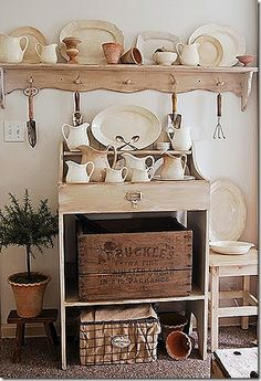 must have for any farmhouse kitchen is ironstone, wood boxes and wire baskets.