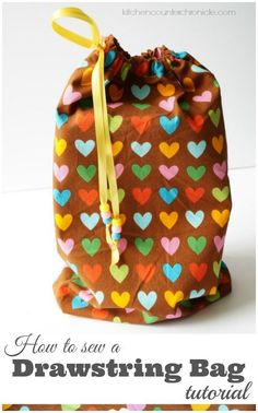 Never buy another glossy gift bag. Follow our simple drawstring bag tutorial & sew your scrap fabric pile into an eco-friendly alternative. | Easy Sewing Project | Green Living | Sewing for Kids | Eco-Living |