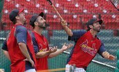 Not sure where Matt Carpenter's hit went, but David Freese and Daniel Descalso seem amused watching it.