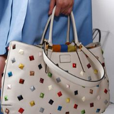 Fendi. Gorgeous, and practical handbag. Just be sure any handbag you buy is to scale with your body frame.