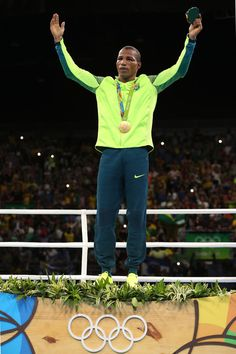Gold medalist Robson Conceicao of Brazil celebrates on the podium during the medal ceremony for the Men's Light (60kg) boxing event on Day 11 of the Rio 2016 Olympic Games at Riocentro - Pavilion 6 on August 16, 2016 in Rio de Janeiro, Brazil.